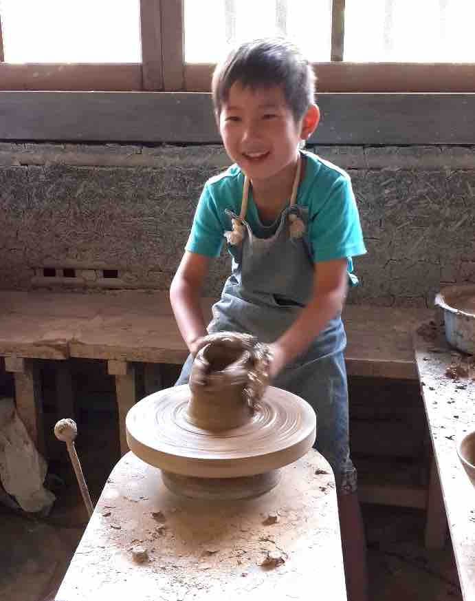 Child making pottery