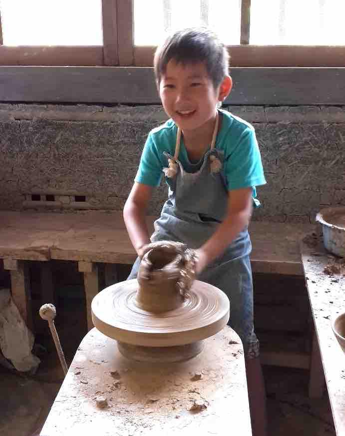 Child making pottery